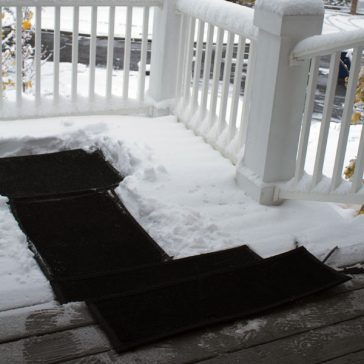ummerstep Heated Snow Melting Door Mat connected to a heated stair mat